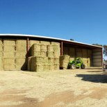 Loading hay in shed