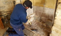 Demolition of old fireplace surrounds