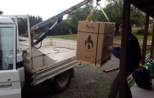 Brains not brawn! Borrowed a friends ute & crane to unload wood heater