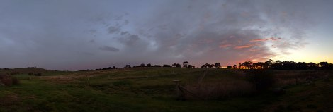 Panorama of sunrise over the hill