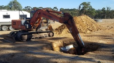 Digging the huge hole for septic tank