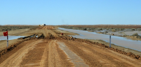 Single lane due to water lapping the side of Birdsville track
