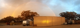On a wet cold arvo a rainbow appeared over the shed
