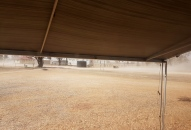 Thallon - hiding in the van during dust storm-the awning survived!